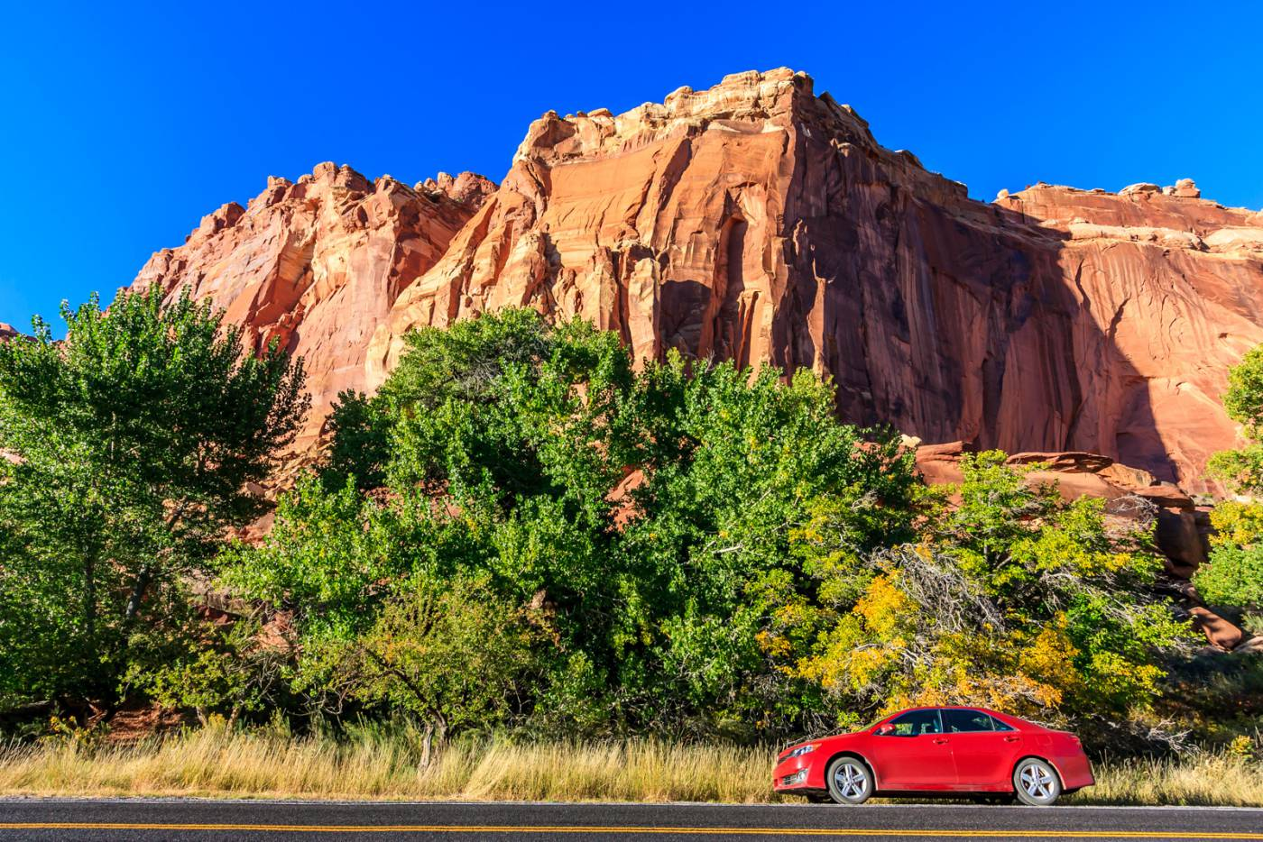 Incorporating the road and my car into a picture in Capital Reef.