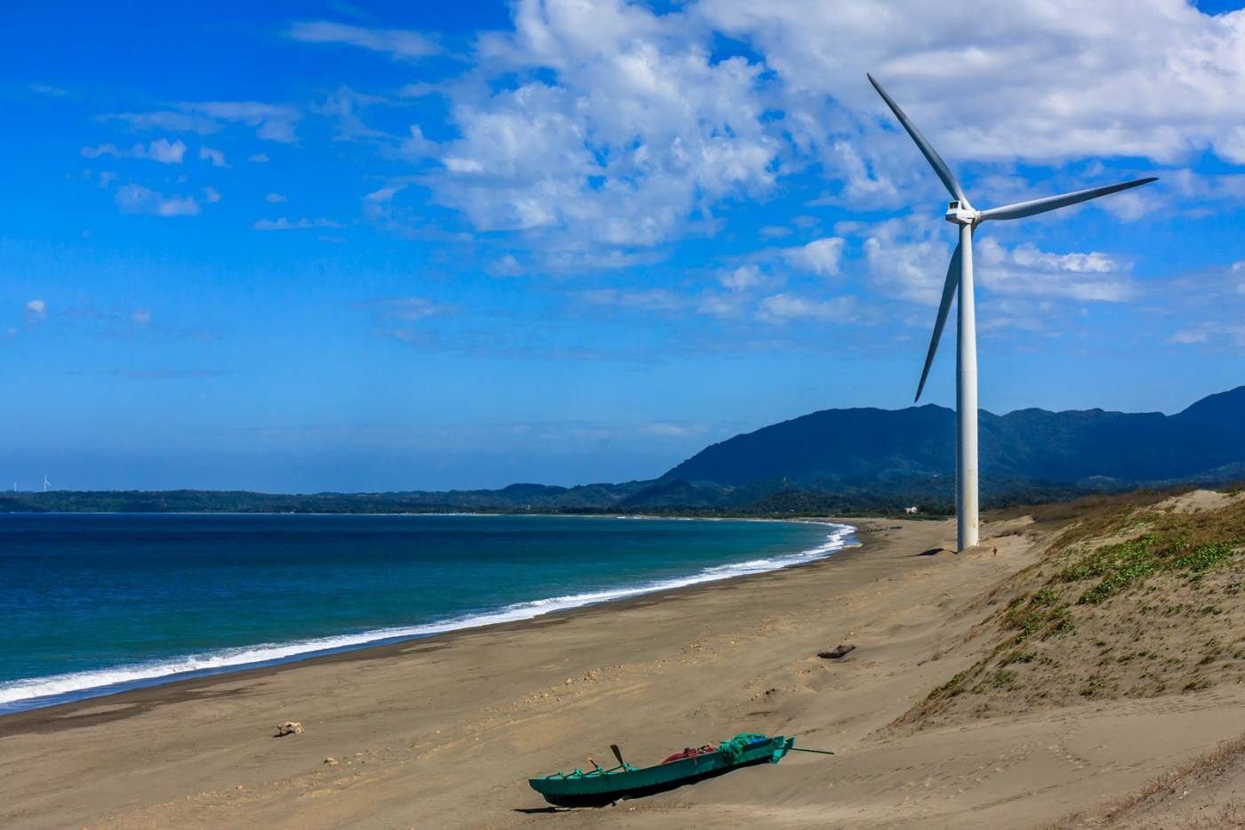 A windmill on the beach.