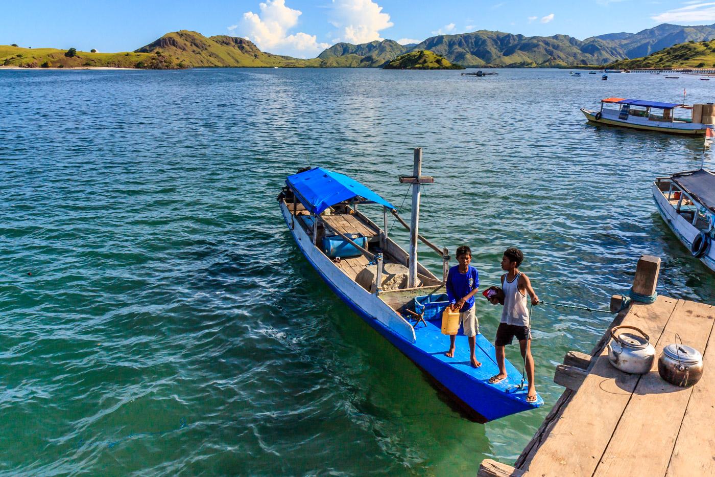Boys unloading a boat.
