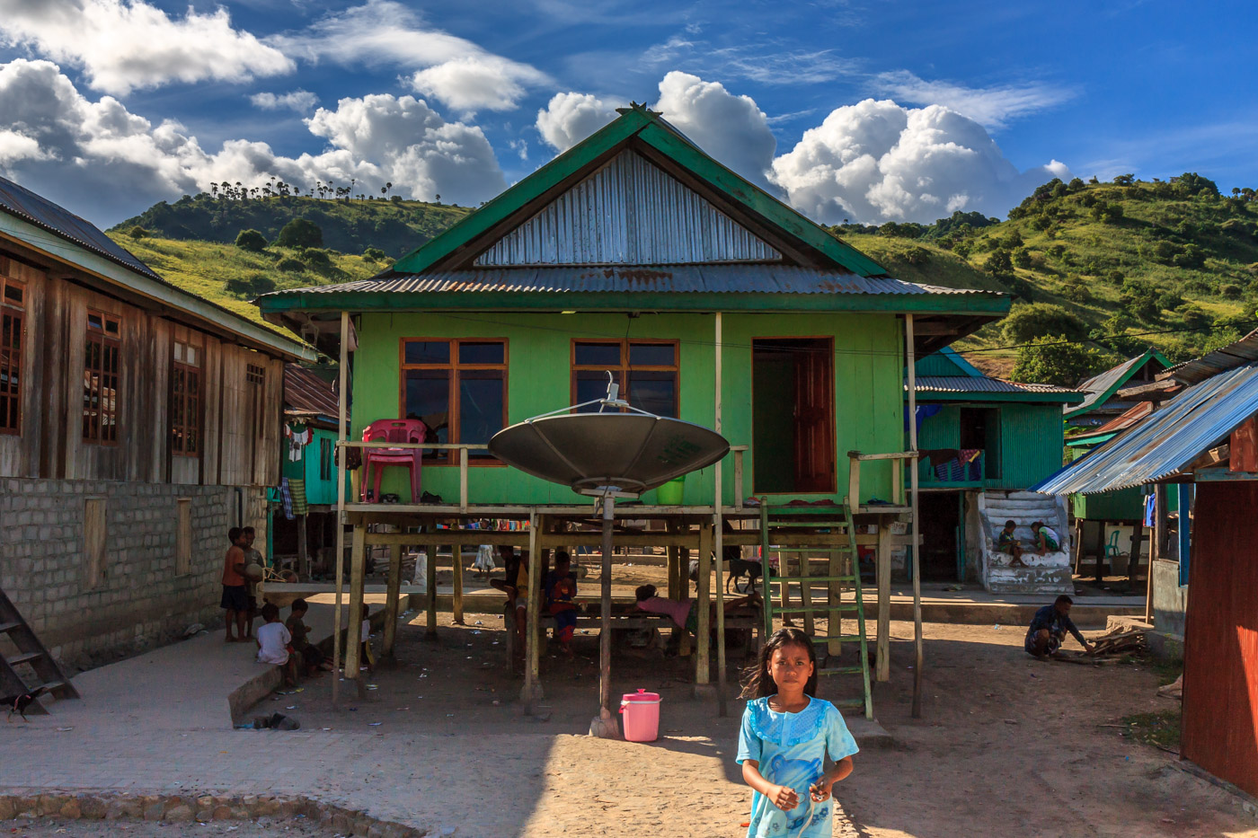Girl and house in Komodo Village.