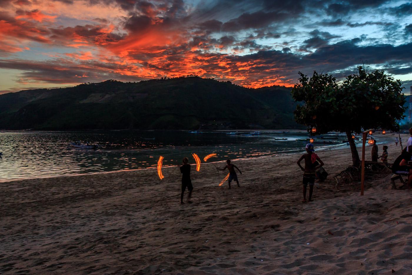 Fire dancers on the beach.