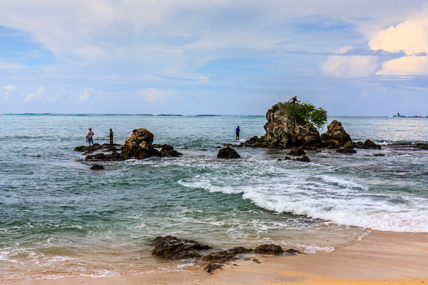 Fishing on the rocks.