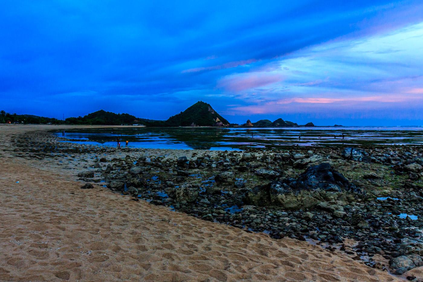 Blue clouds, low tide.