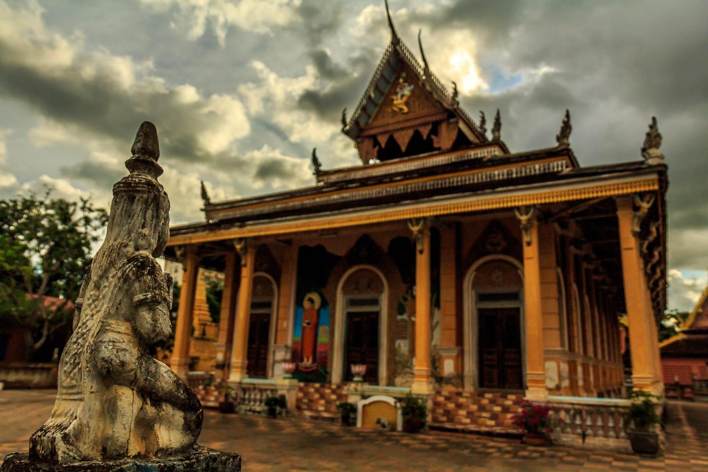 Admiring one of Battambang's many modern temples.