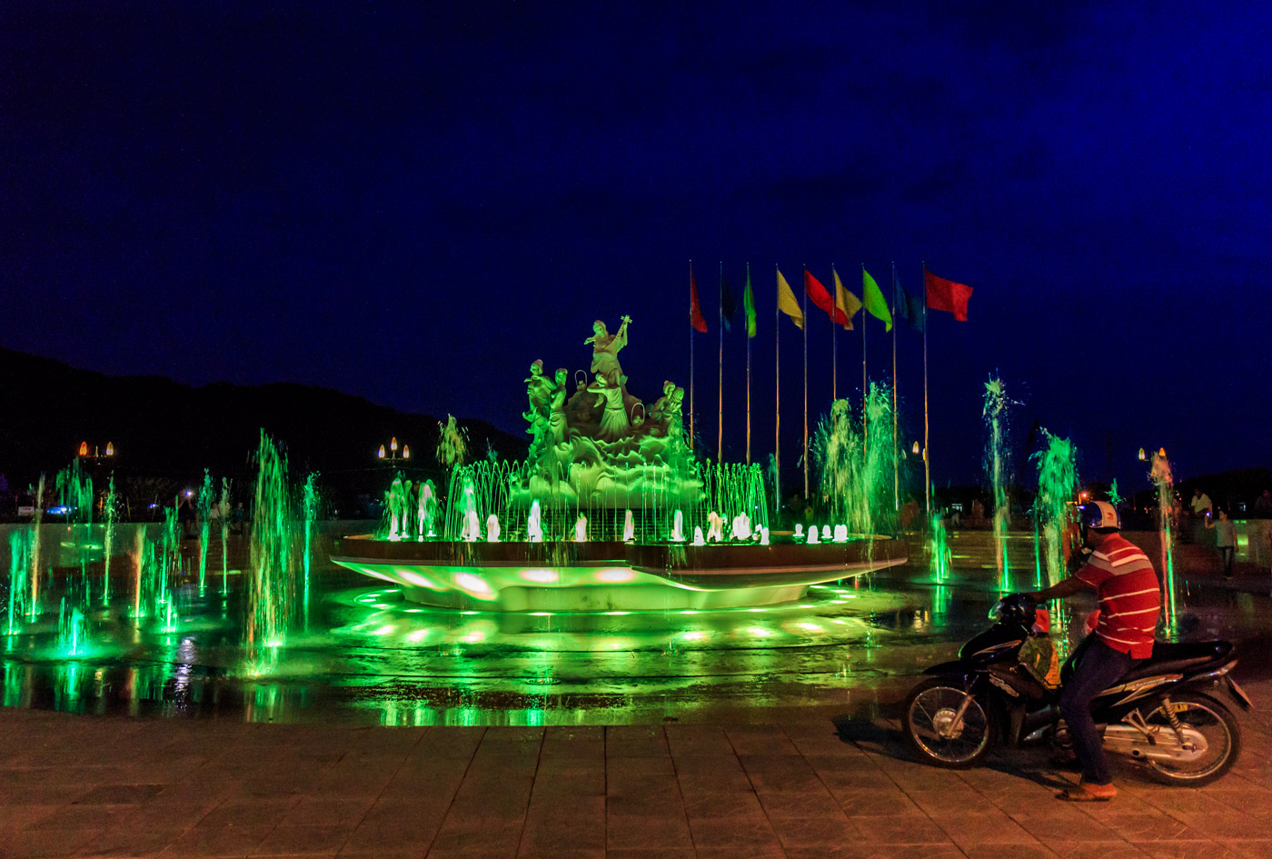 The fountain is lit up at night.