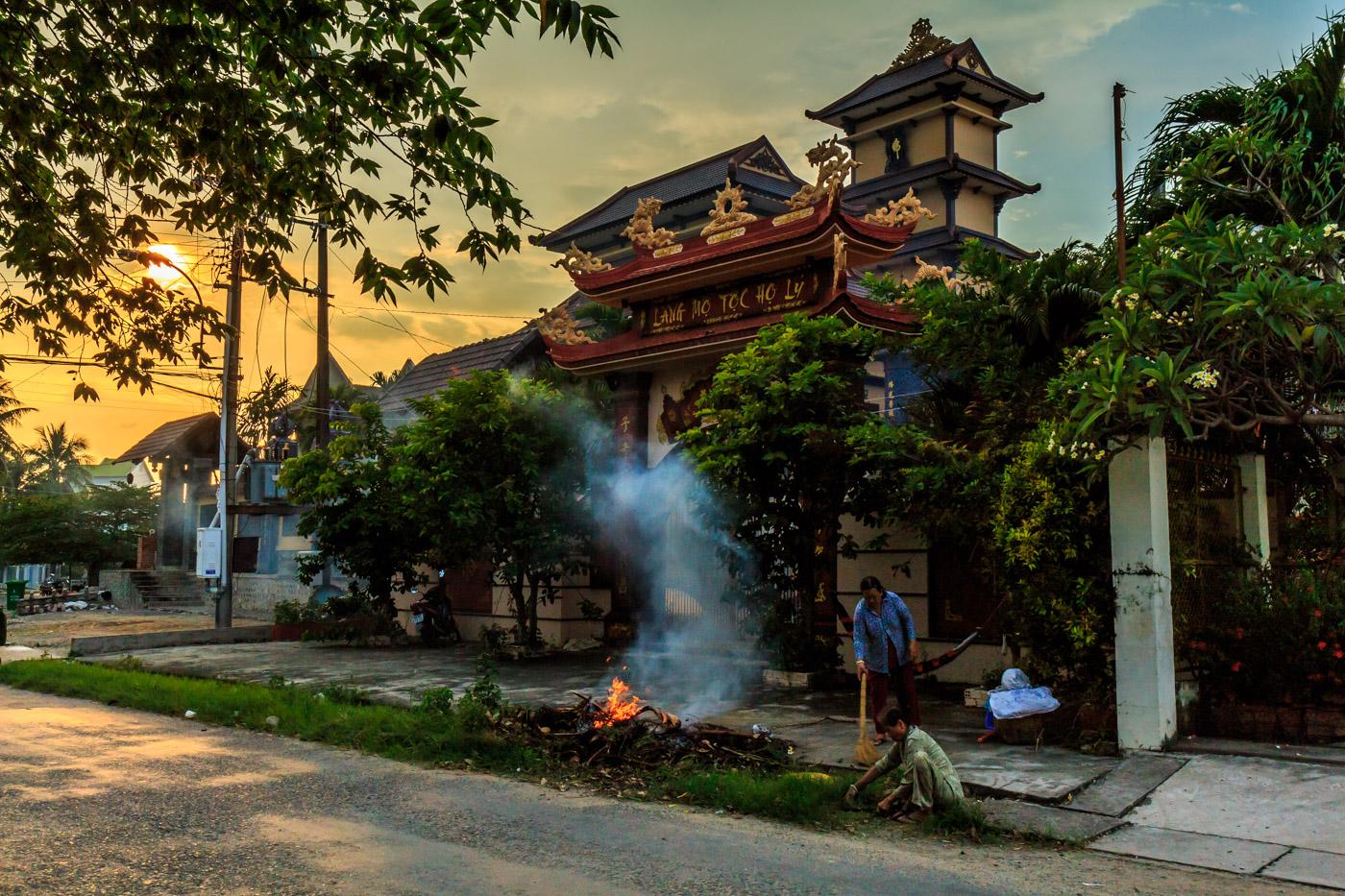 Burning trash outside a temple.