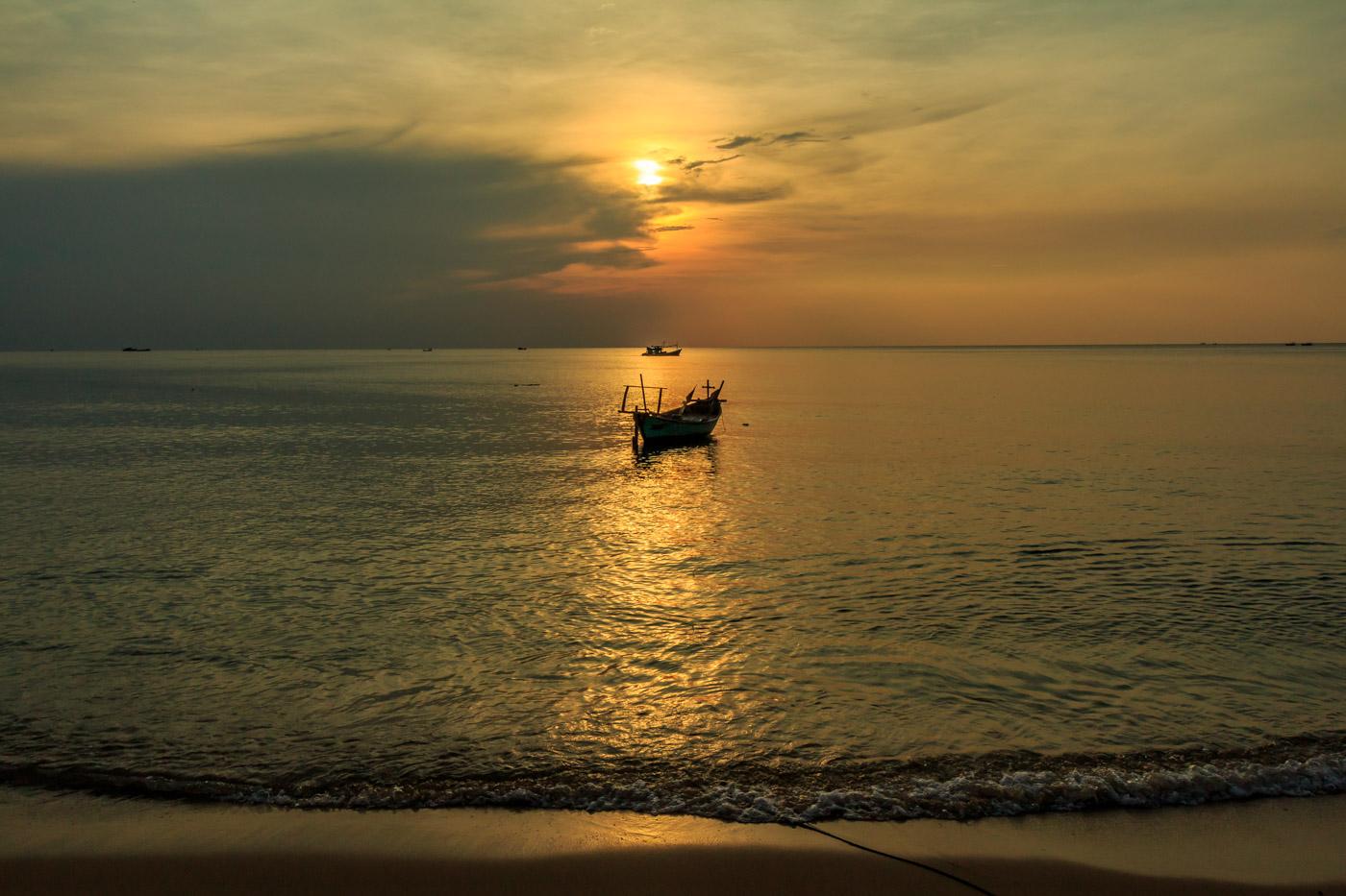 The sun goes down on the beach.