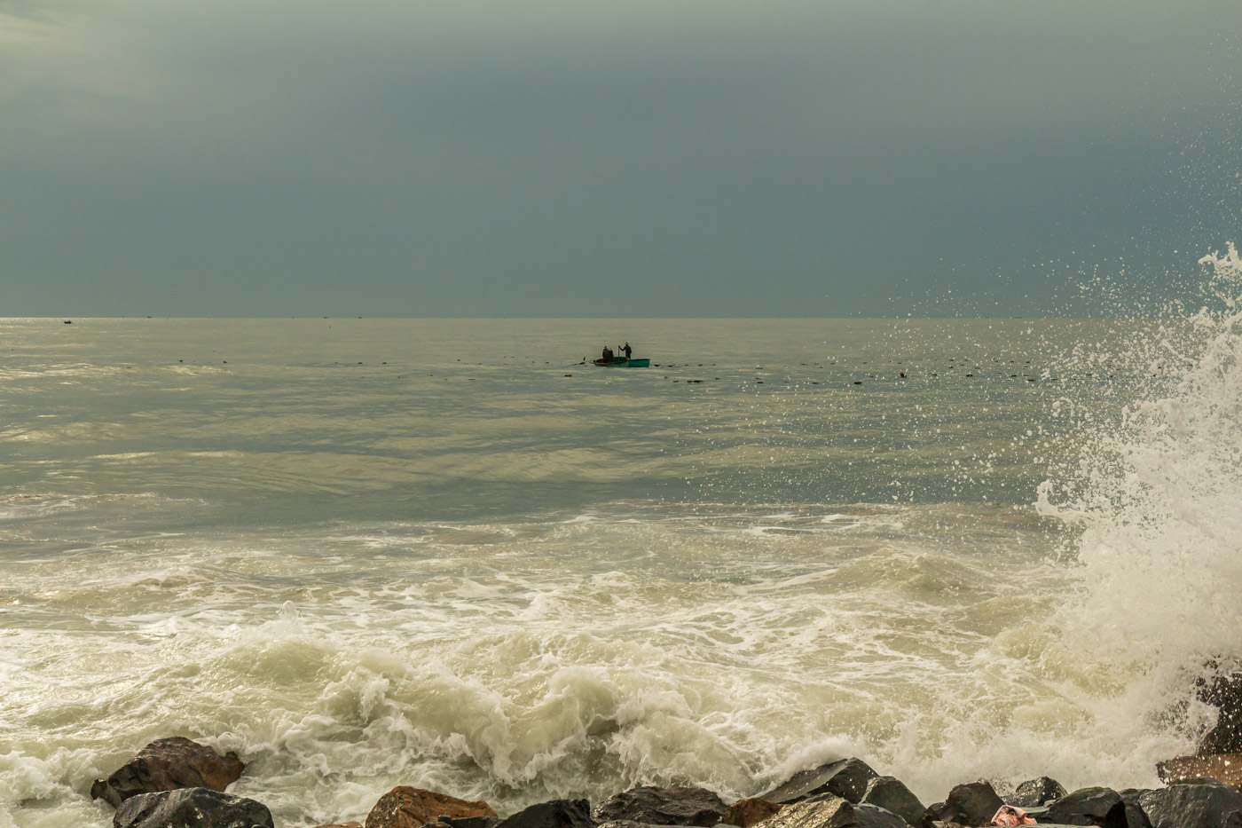 Fishermen and crashing waves.