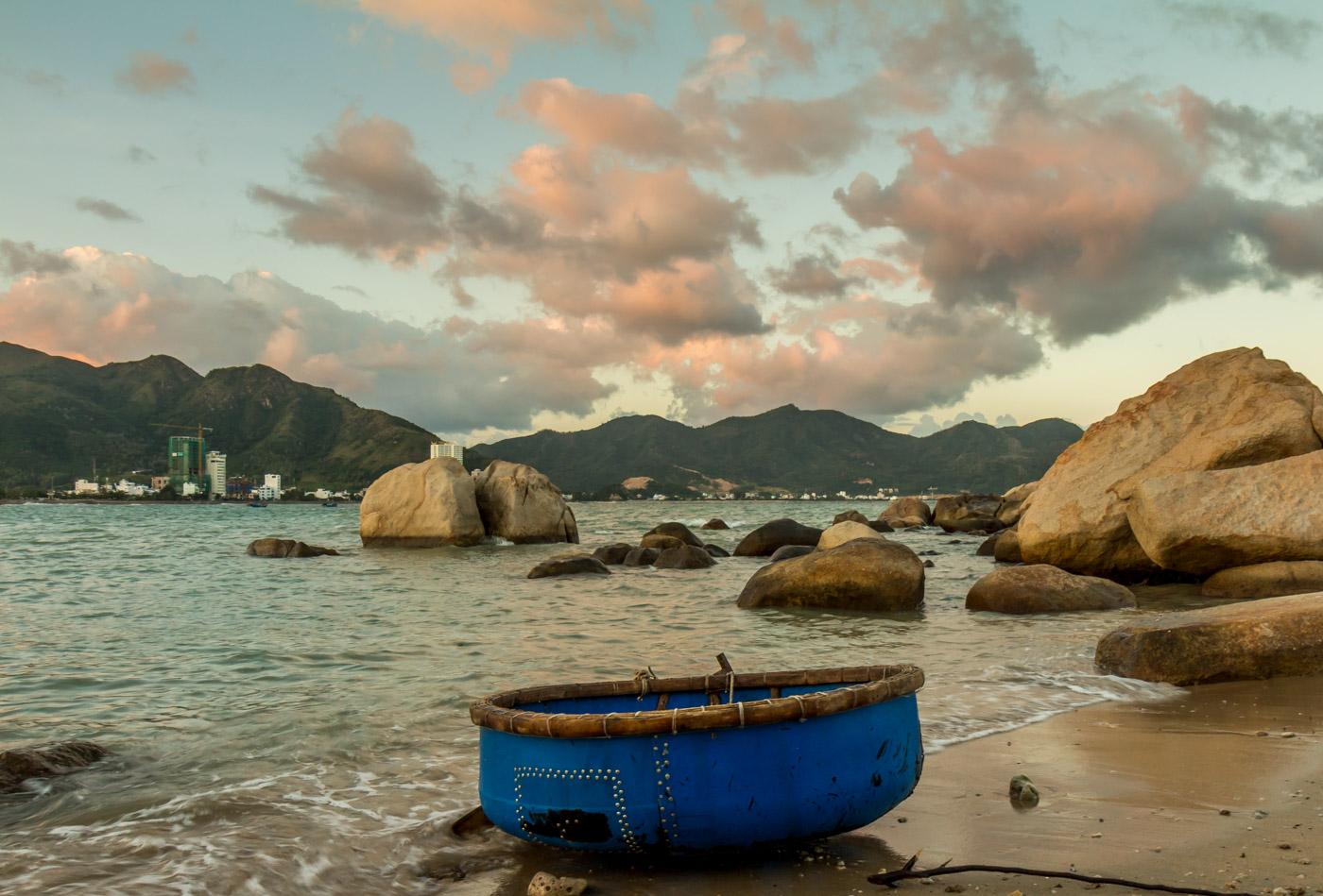 Fishing boat on the rocks.