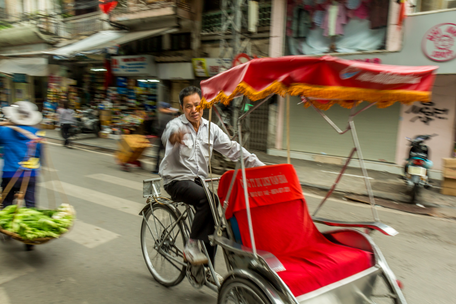 Cyclo drivers are eager to get you to sit down.