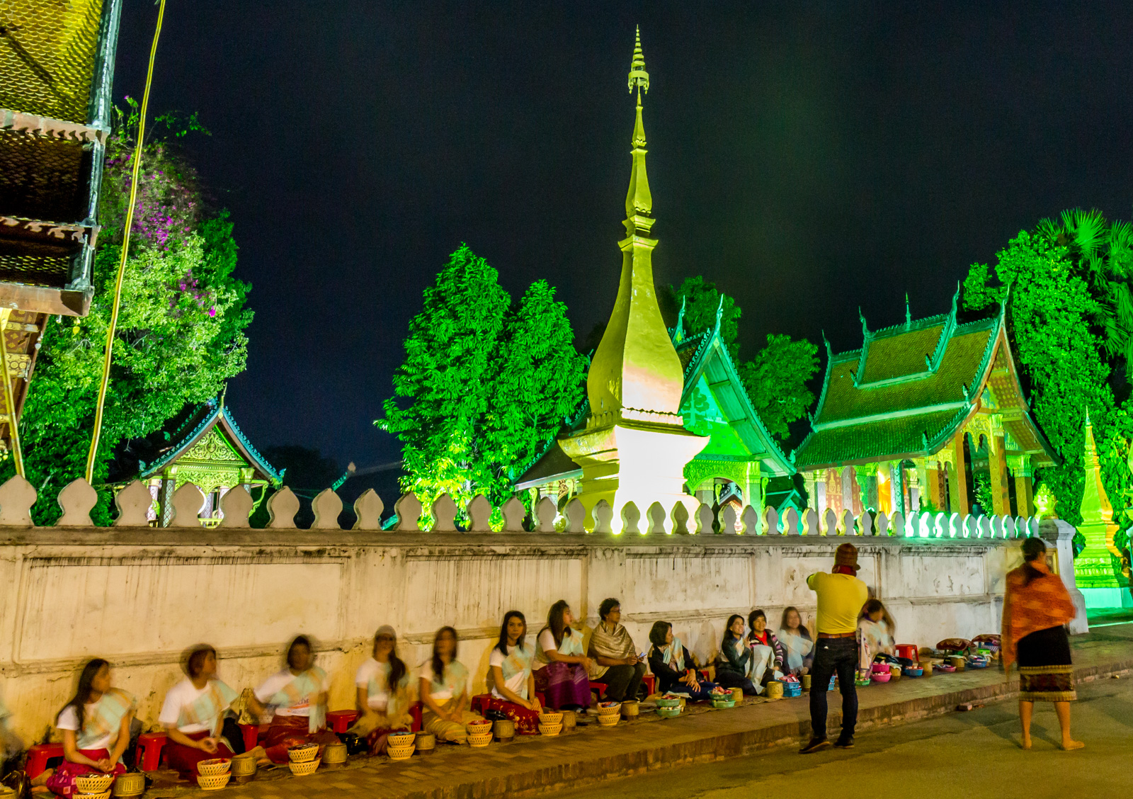 Locals await the monks.