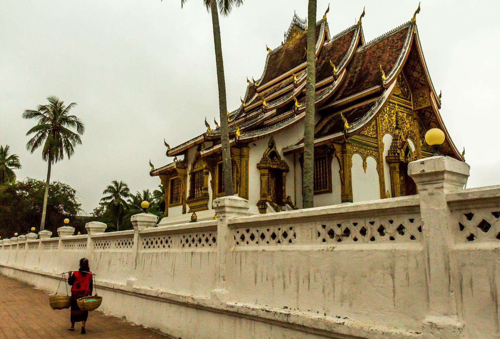 A vendor passes the palace.